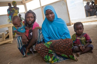 Nigerian refugee Kadija, 19, walked for four days with her child on her back before reaching Kousseri camp in Cameroon in March 2015.