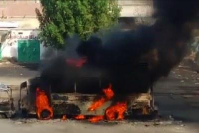 A bus burns following violence in Port Sudan