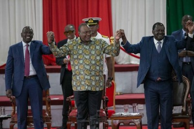 President Uhuru Kenyatta (centre) in a show of unity with Deputy President William Ruto (left) and opposition leader Raila Odinga, during the launch of the Building Bridges Initiative report at Bomas (file photo).