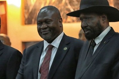 Salva Kiir, President of South Sudan, right, with Riek Machar, left (file photo).