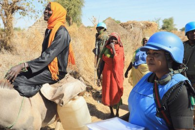 UNAMID peacekeepers provide protection to local women in Aurokuom village farming area south Zalingei, Central Darfur (file photo).