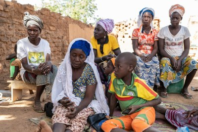 Internally displaced Zeinabou Sawadoga, 42, is surrounded by family in the grounds of her relative's courtyard in Kaya, Burkina Faso where she is now seeking shelter.