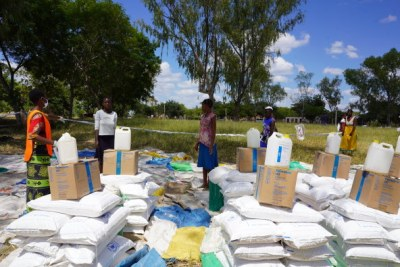 At World Food Programme food distribution points in Zimbabwe, community members stand at least one metre apart and collect their food in groups of five, to prevent overcrowding.