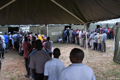People queue to vote in Tanzania's election on October 28, 2020.