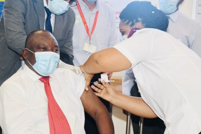 President Cyril Ramaphosa joins healthcare workers in receiving the Johnson & Johnson coronavirus vaccination (file photo).