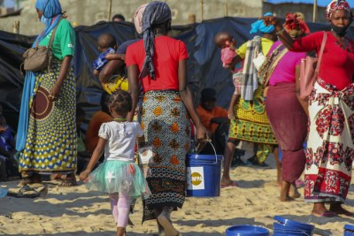 Displaced women receiving dignity kits supported by UNFPA, at Paquitequete beach, Pemba City, Cabo Delgado.