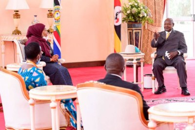 Ugandan President Yoweri Kaguta Museveni, right, gestures during a meeting with Tanzanian President Samia Suluhu Hassan that preceded the signing of the East African Crude Oil Pipeline (EACOP) Tripartite Project Agreement at State House Entebbe on April 11, 2021.