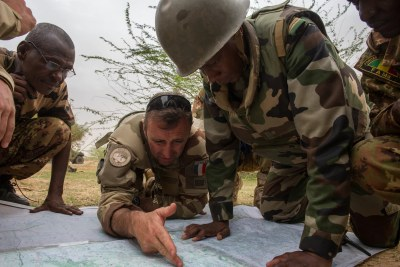 A French soldier works with African military leaders as part of Operation Barkhane.