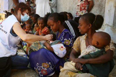 An MSF nurse checks screens a child for malnutrition at a mobile clinic in Adiftaw in the Tigray region.