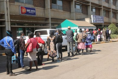 People queue for Covid-19 vaccine shots at Zimbabwe's largest health institution, Parirenyatwa Hospital, in Harare, June 08, 2021.