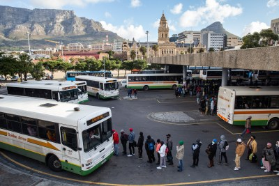 Commuters wait for a bus at the Cape Town central station.