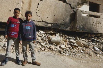 Young boys stand in front of a destroyed building in Benghazi Old Town in Libya (file image).